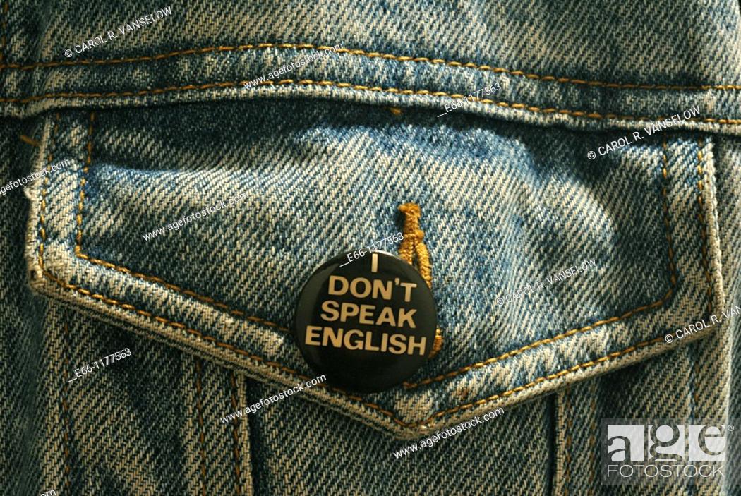 Stock Photo: button saying 'I don't speak English' on pocket of blue jean jacket.