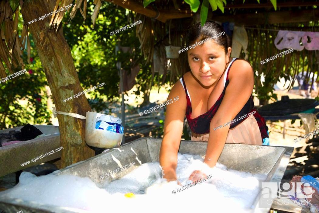 Stock Photo: Portrait of a young woman washing clothes, Papantla, Veracruz, Mexico.