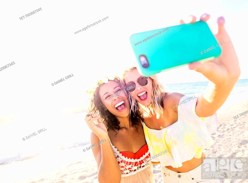 Stock Photo: Female friends on beach.