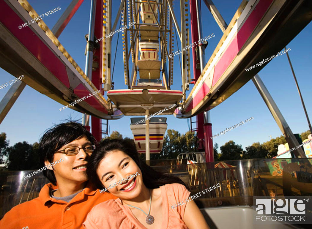 Stock Photo: Couple riding a Ferris wheel together.