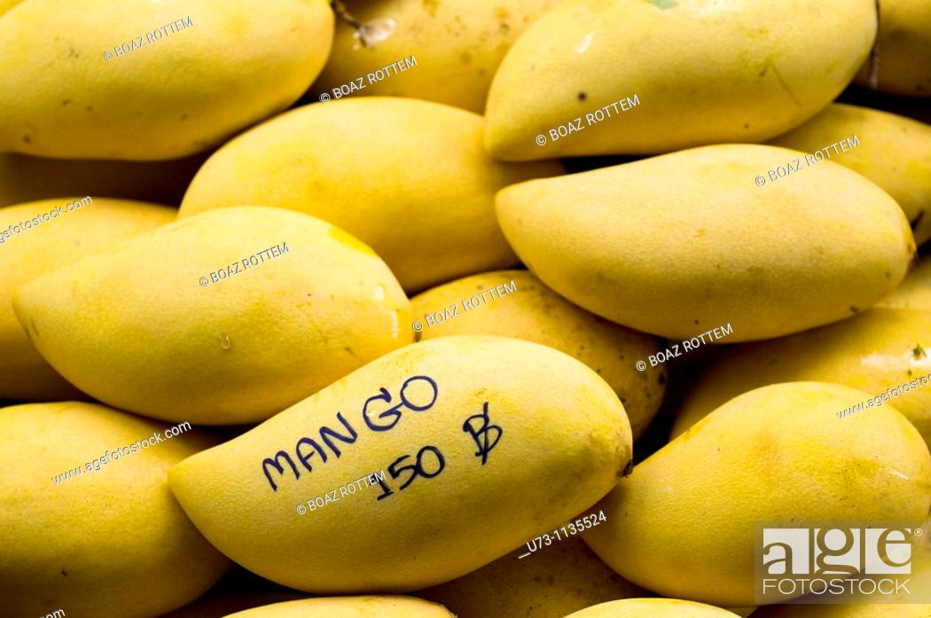 Stock Photo: Mango sold in the market for 150 bhat a kg.