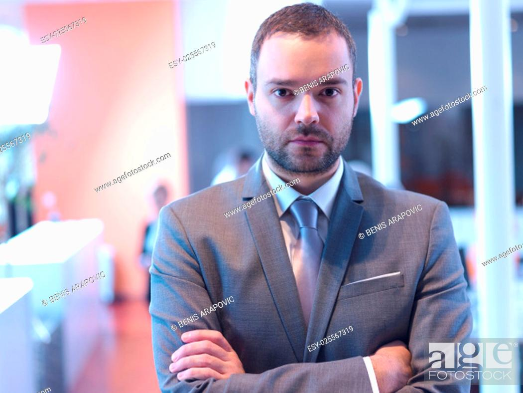 Stock Photo: happy young business man portrait at modern meeting office indoors.