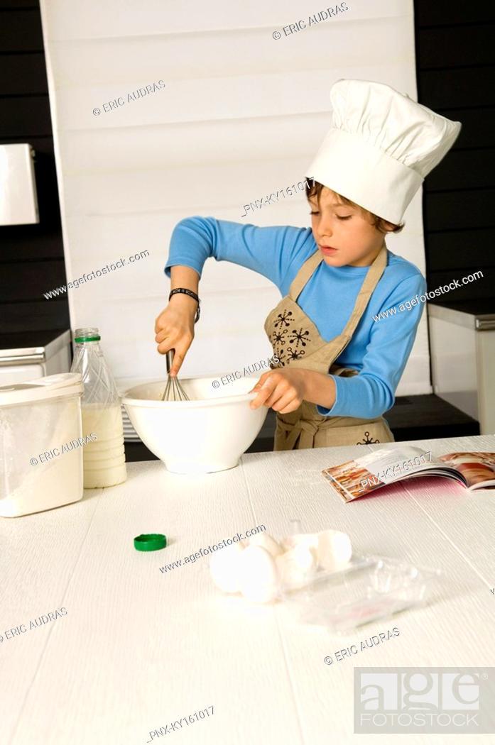 Stock Photo: Boy making a cake.