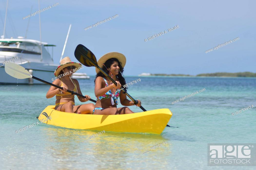 Stock Photo: Beautiful Girls on Kayak with rowing enjoing summer at caribbean Beach Vacation Travel.