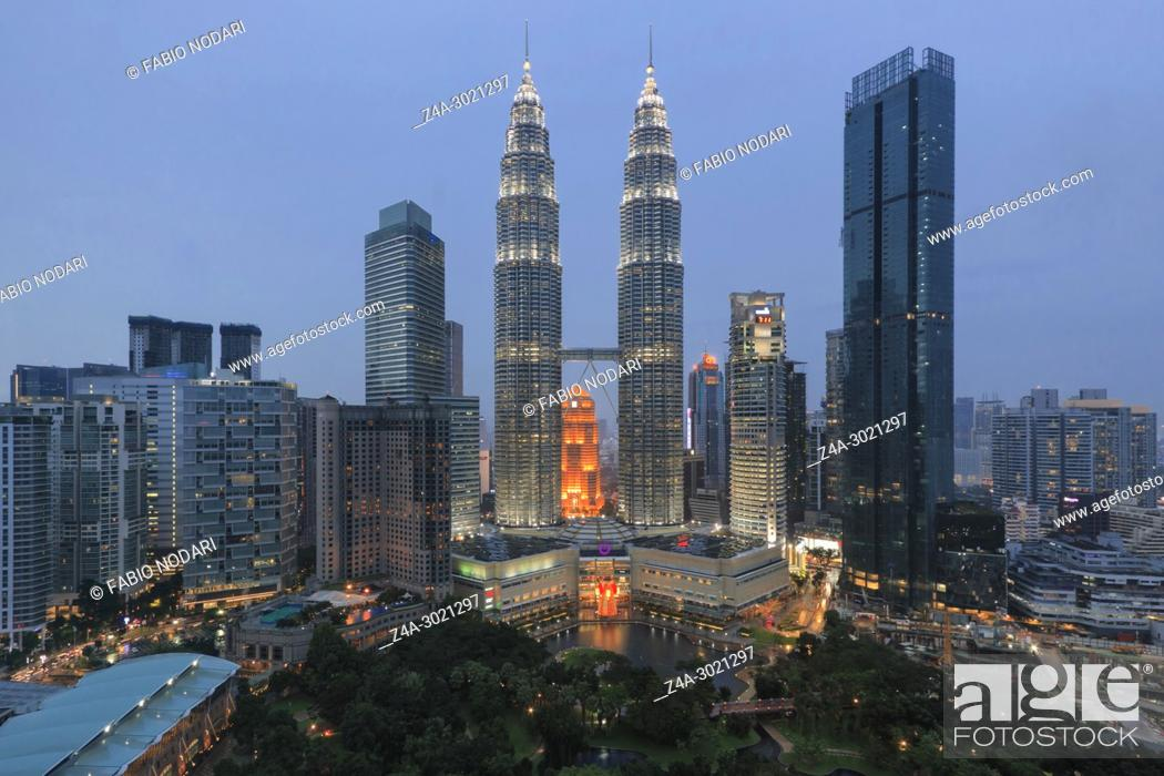 Stock Photo: Cityscape of Kuala Lumpur at sunset with Petronas Towers.
