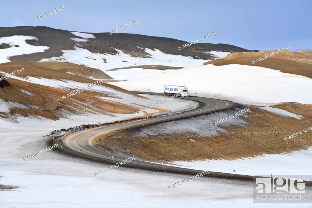 Stock Photo: Truck on pass road between Reykjahlid and geothermal area Hverarönd, winter, at mountain Námafjall, Myvatn area, North Iceland.