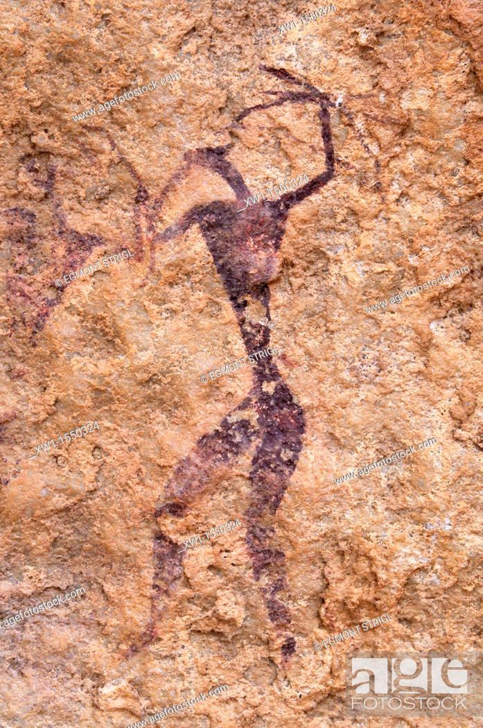 Stock Photo: painted warrior, neolithic rockart at Tin Meskis, Adrar n' Ahnet, Algeria, Sahara, North Africa.