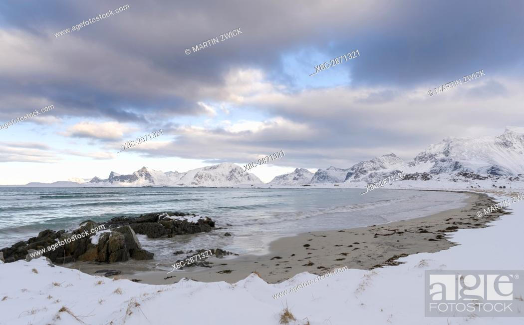 Stock Photo: Ytresand Beach near village Fredvang, view over to island Flakstadoya. The island Moseknesoya, the Lofoten islands in northern Norway during winter.