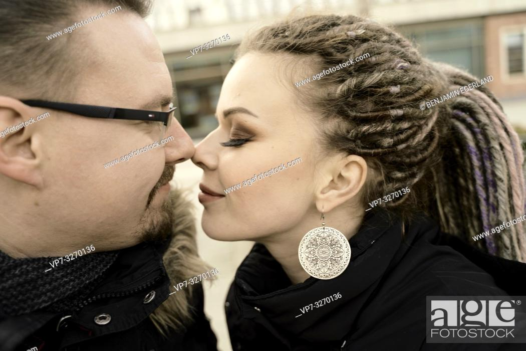 Stock Photo: couple together in city, nose to nose, nudging noses, face to face, in Cottbus, Brandenburg, Germany.