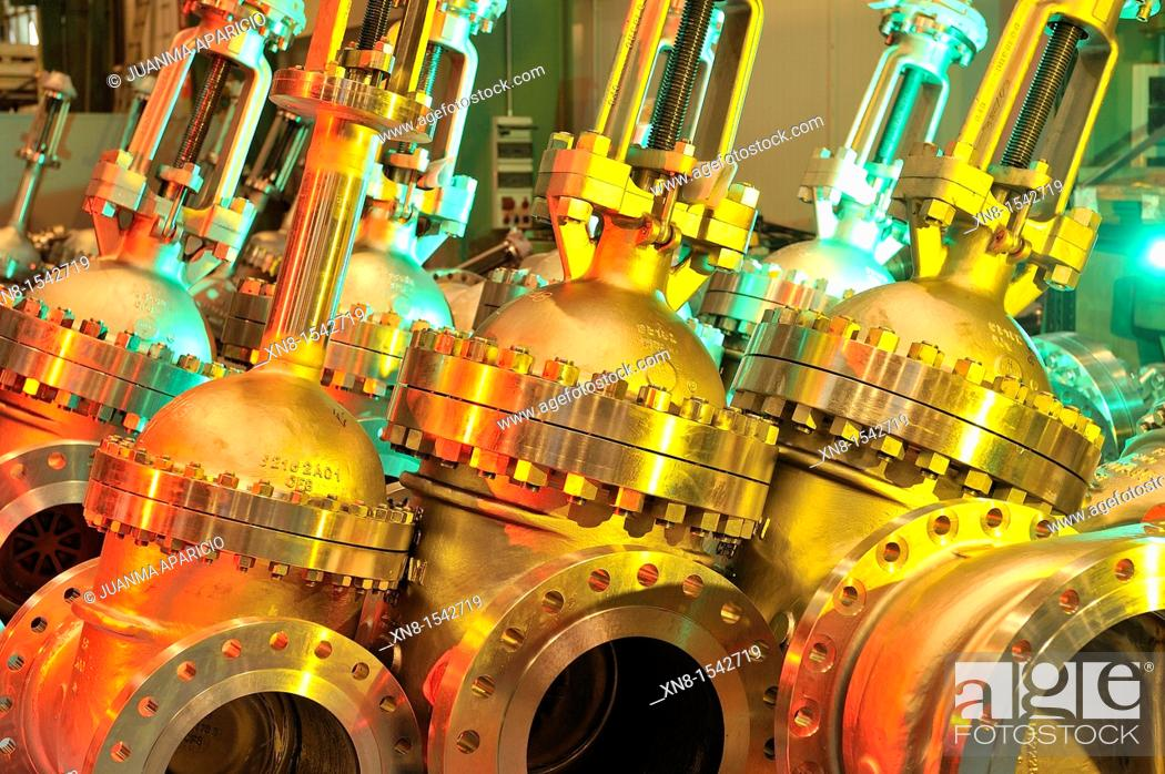 Stock Photo: Industrial valves illuminated with colored gels.