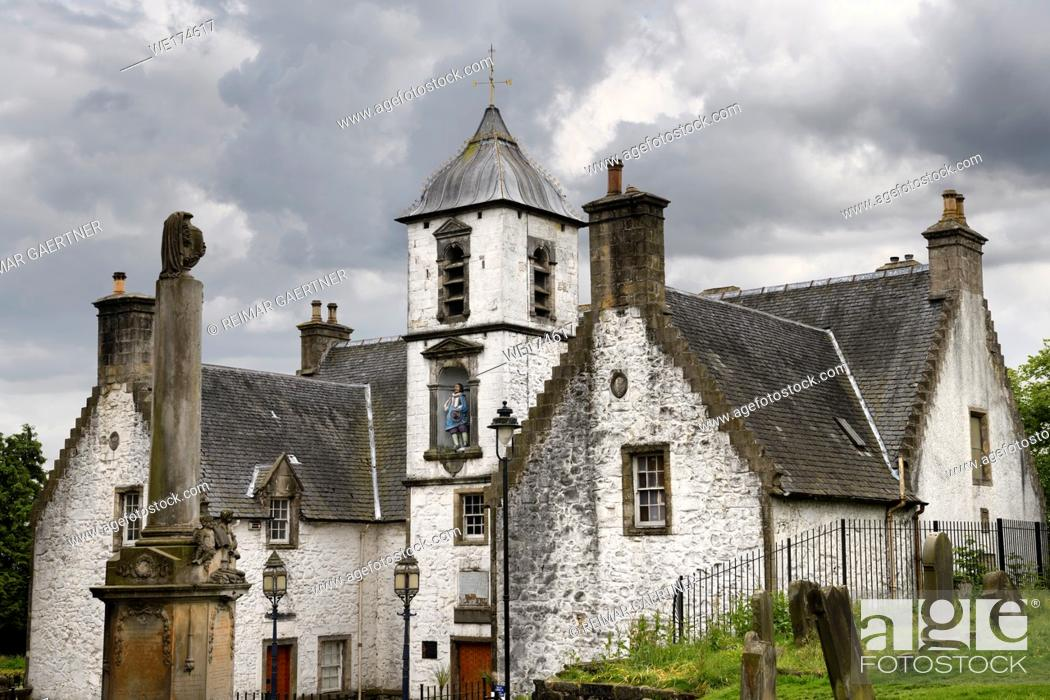 Stock Photo: 17th Century Burgh architecture of Cowanes Hospital with statue of John Cowane at Holy Rude Old Town cemetery on Castle Hill of Stirling Scotland.