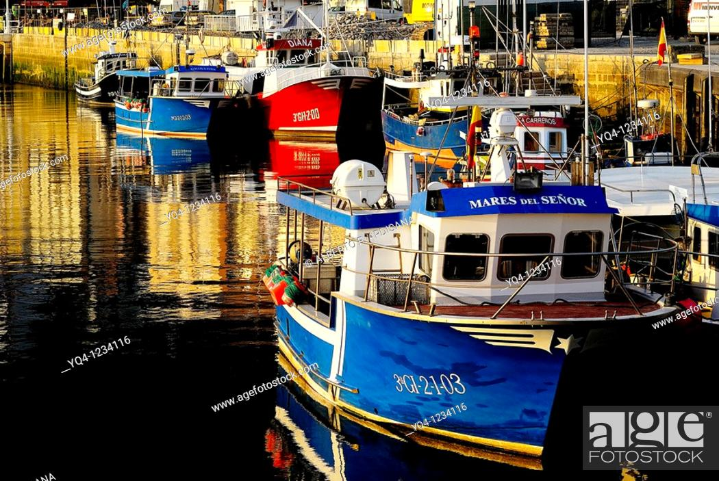 Stock Photo: Fishing boats in the port of Ribadesella, Asturias.
