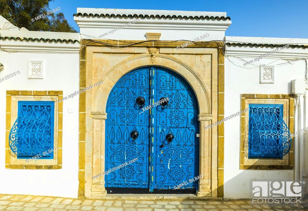 Stock Photo: Spiked wooden door in the medina. Sidi Bou Said village. Tunisia, Africa.