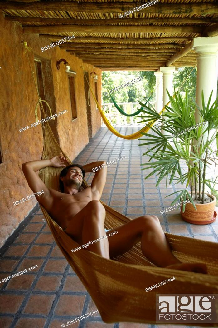 Stock Photo: Hispanic man laying in hammock.