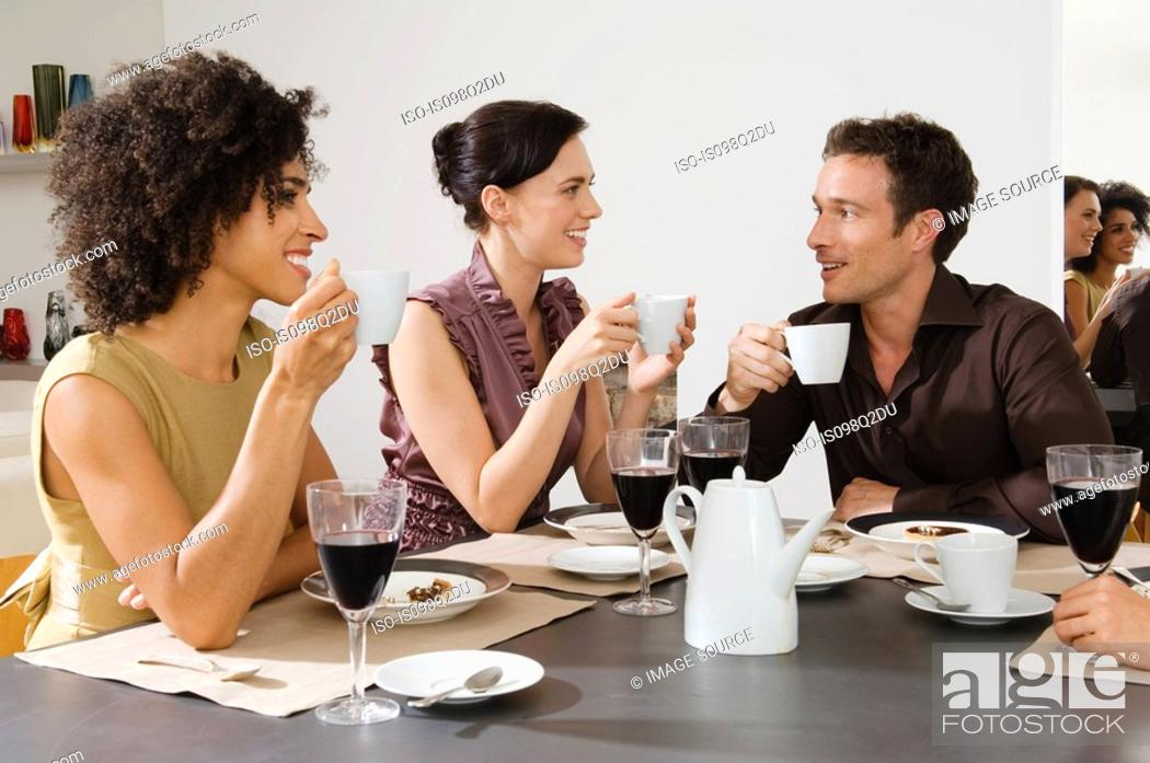 Stock Photo: Friends talking over coffee.