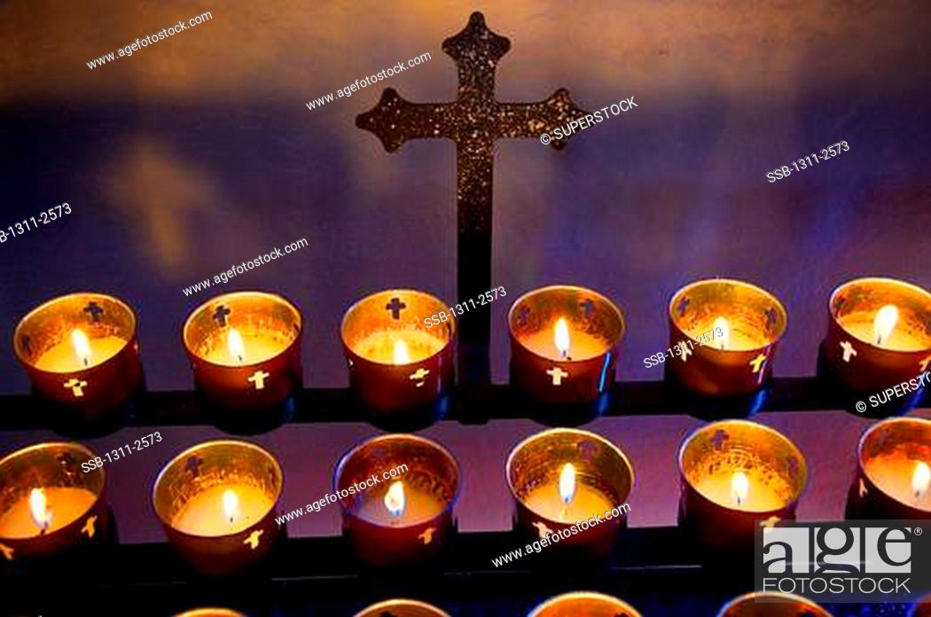 Stock Photo: Votive candles burning in a cathedral, St. Francis Cathedral, Santa Fe, New Mexico, USA.