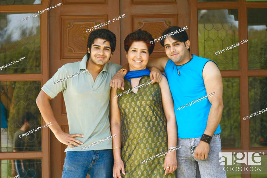 Stock Photo: Portrait of a mature woman standing with her two sons.