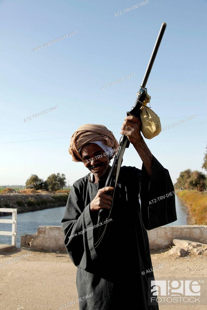 Stock Photo: MUSLIM MAN WITH GUN; NAGAA EL-SHAIKH ABOU AZOUZ, EGYPT; 07/01/2013.