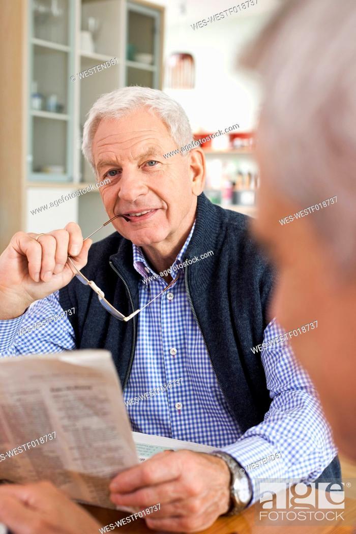 Stock Photo: Germany, Leipzig, Senior man reading newspaper.