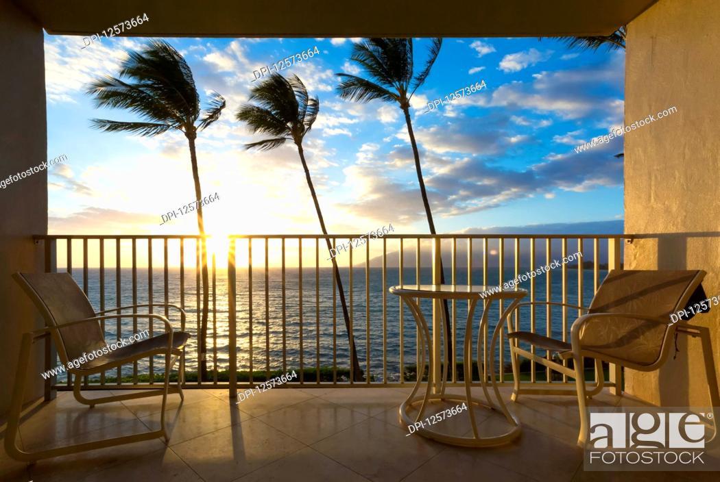 Stock Photo: Seating on a balcony with a tropical view, Kamaole One and Two beaches, Kamaole Beach Park; Kihei, Maui, Hawaii, United States of America.