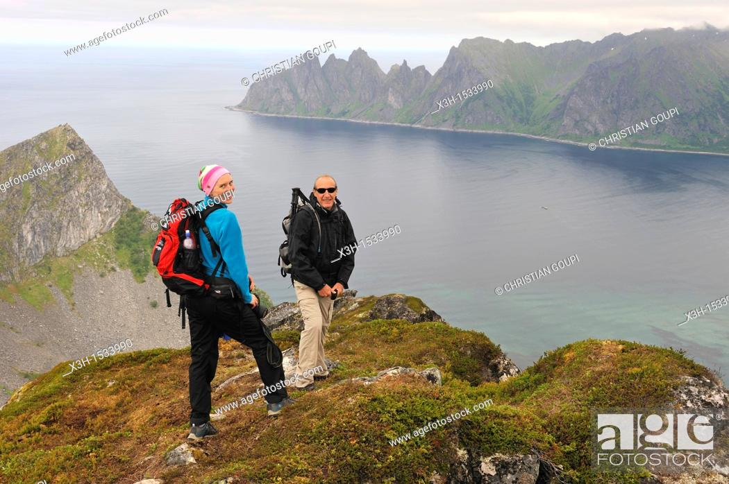 Stock Photo: couple on Husfjellet mountain, Senja island County of Troms, Norway, Northern Europe.