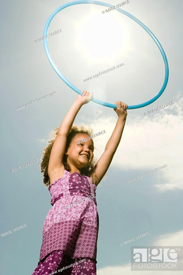 Stock Photo: Girl with a plastic hoop.