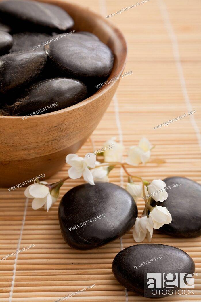 Stock Photo: Lastone therapy stones in spa, Studio shot.