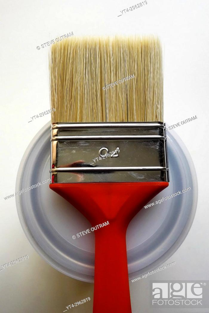 Stock Photo: Red Paint Brush on top of Can.