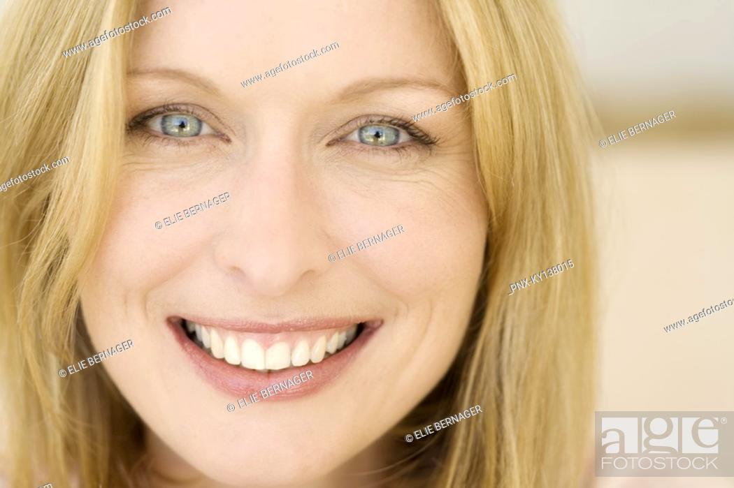Stock Photo: Portrait of a young smiling woman.