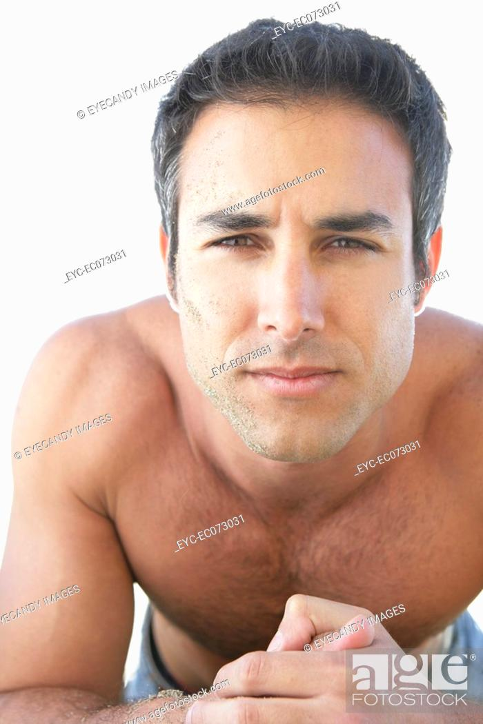 Stock Photo: Portrait of young bare-chested man.