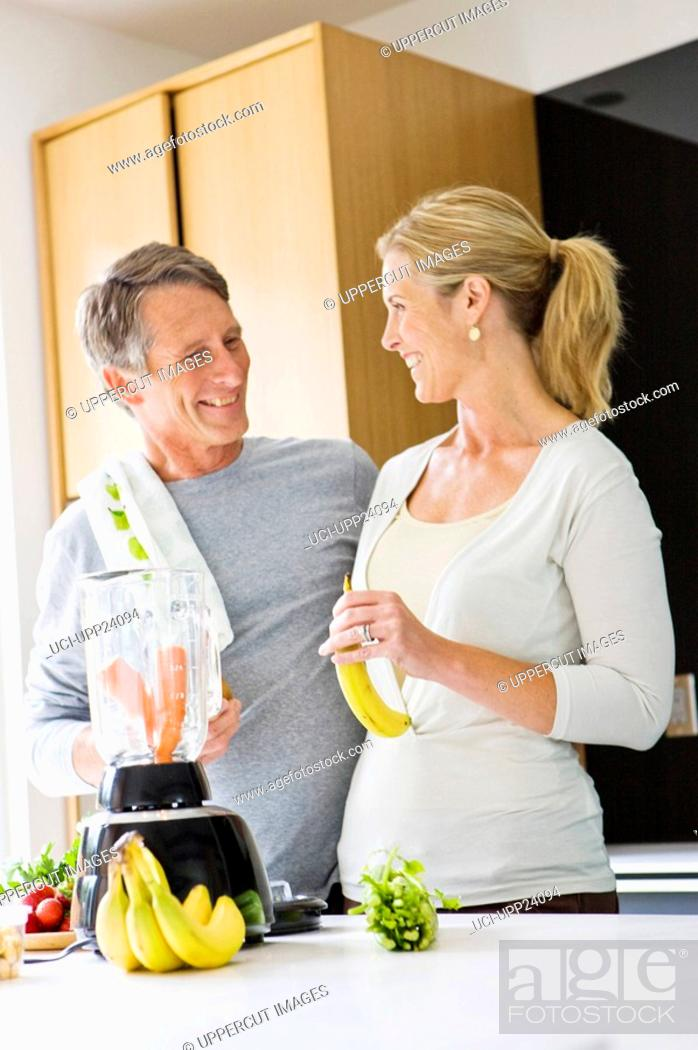 Stock Photo: Couple preparing health shake in kitchen,.