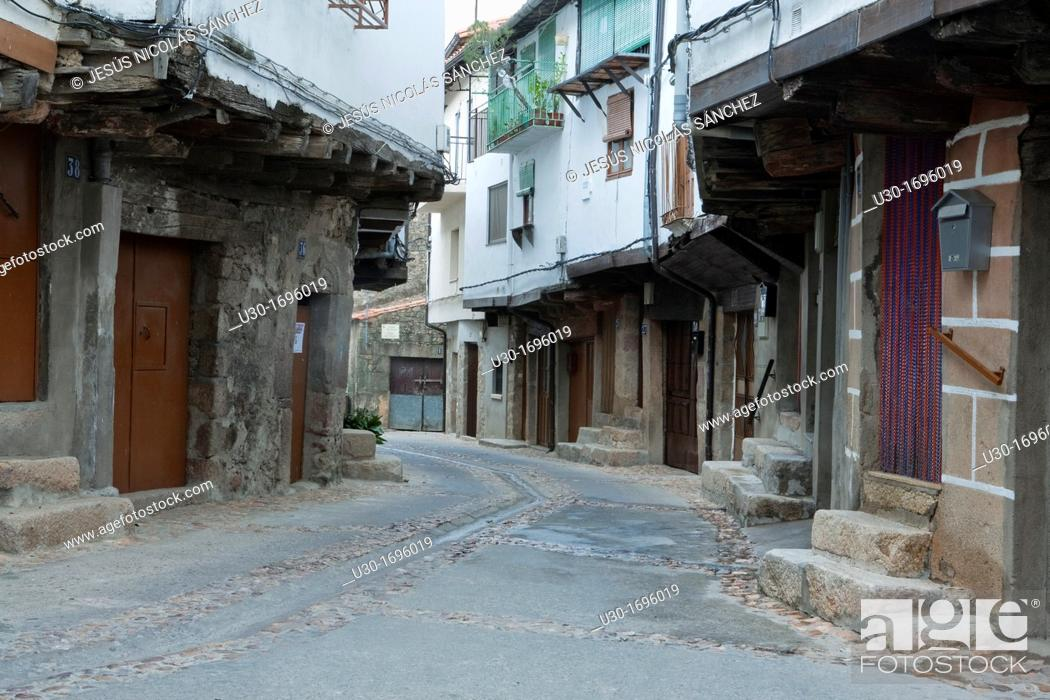 Stock Photo: Typical street and houses of San Martín de Trevejo, small village declarated Historical-Artistic Site, located in Sierra de Gata  Cáceres  Extremadura  Spain.
