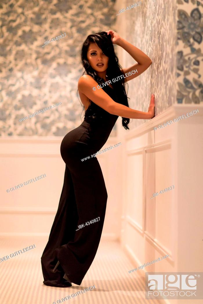 Stock Photo: Young woman in black evening dress, fashion, lifestyle.
