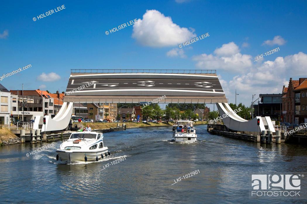 Stock Photo: Le Boat Elegance houseboat and Scheepsdalebrug drawbridge on the Bruges - Ostend canal, near Bruges Brugge, Flemish Region, Belgium.