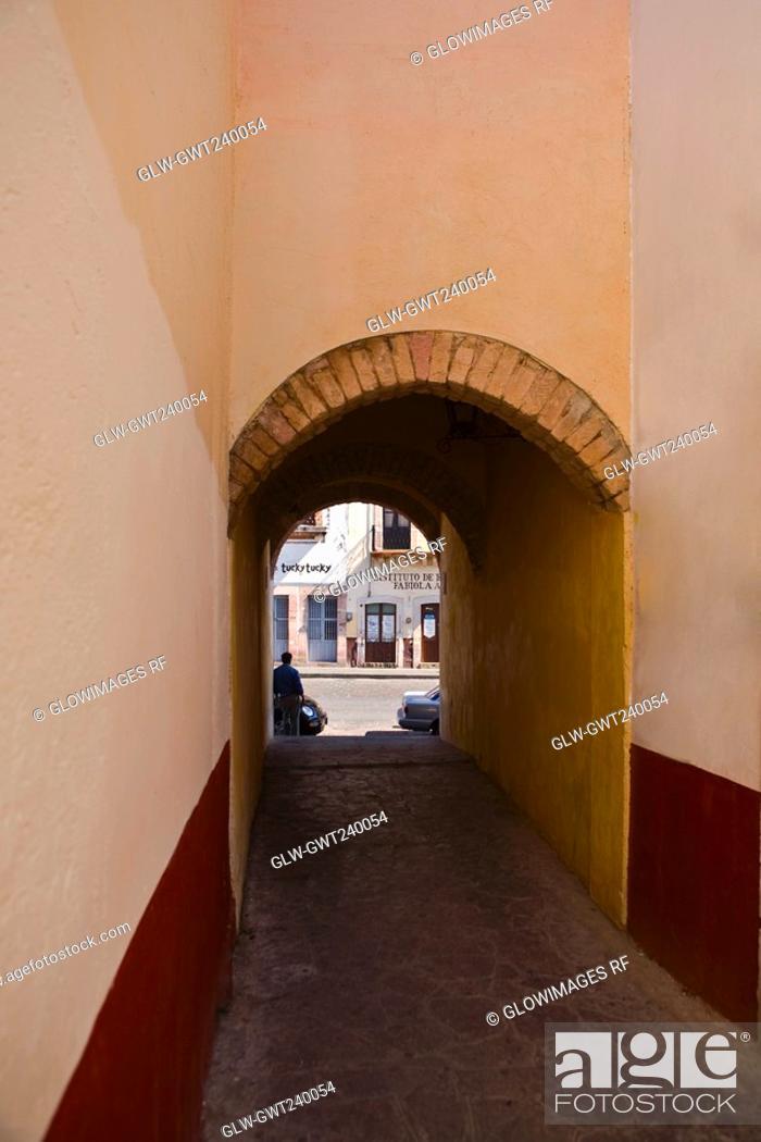 Stock Photo: Alley passing through an archway, Alcaiceria De Gomez, Zacatecas State, Mexico.