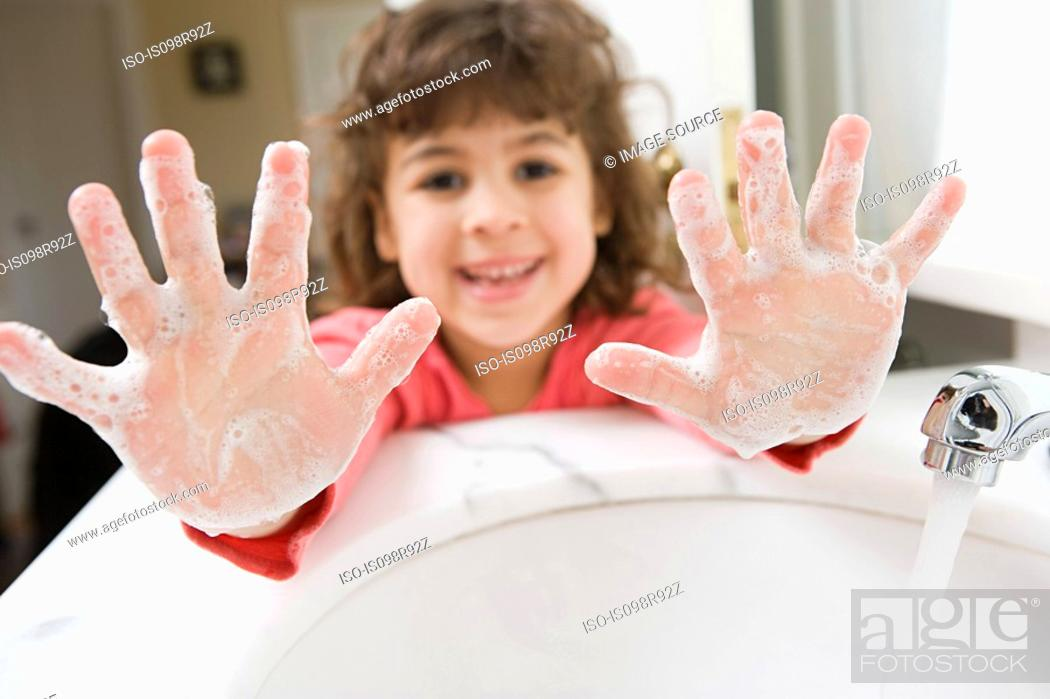 Stock Photo: Girl with soap on her hands.