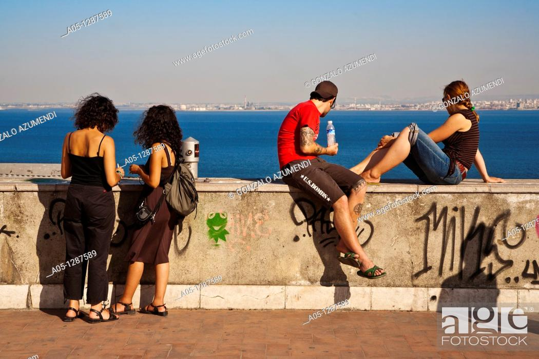 Stock Photo: Young people. Alfama district, Lisbon, Portugal.
