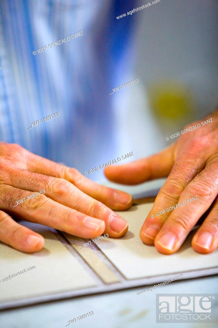 Stock Photo: Craftsman bookbinder working in manual binding of a book or craft book.