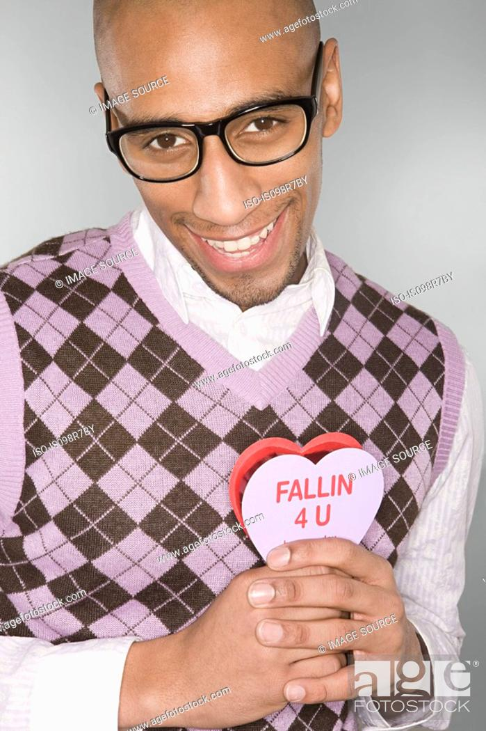 Stock Photo: Nerdy man holding a love heart.