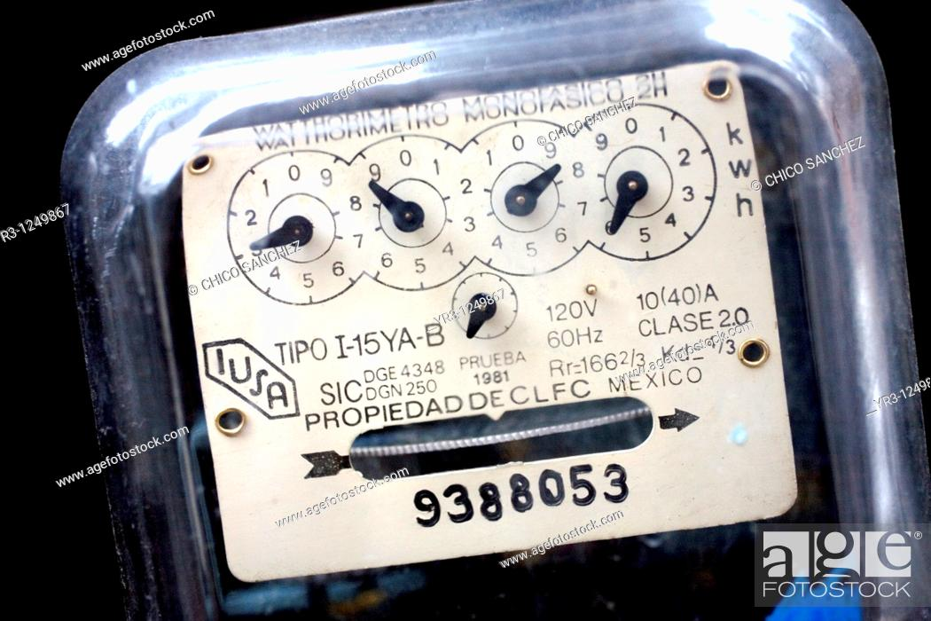 Stock Photo: A detail of an electricity meter hang on a wall in an apartment buiding in Mexico City. The Mexican government shut down the state-run power company Luz y.