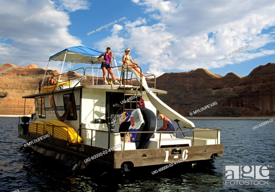 Stock Photo: A HOUSE BOAT enters REFLECTION CANYON, one of 96 arms of LAKE POWELL NATIONAL RECREATION AREA - UTAH.