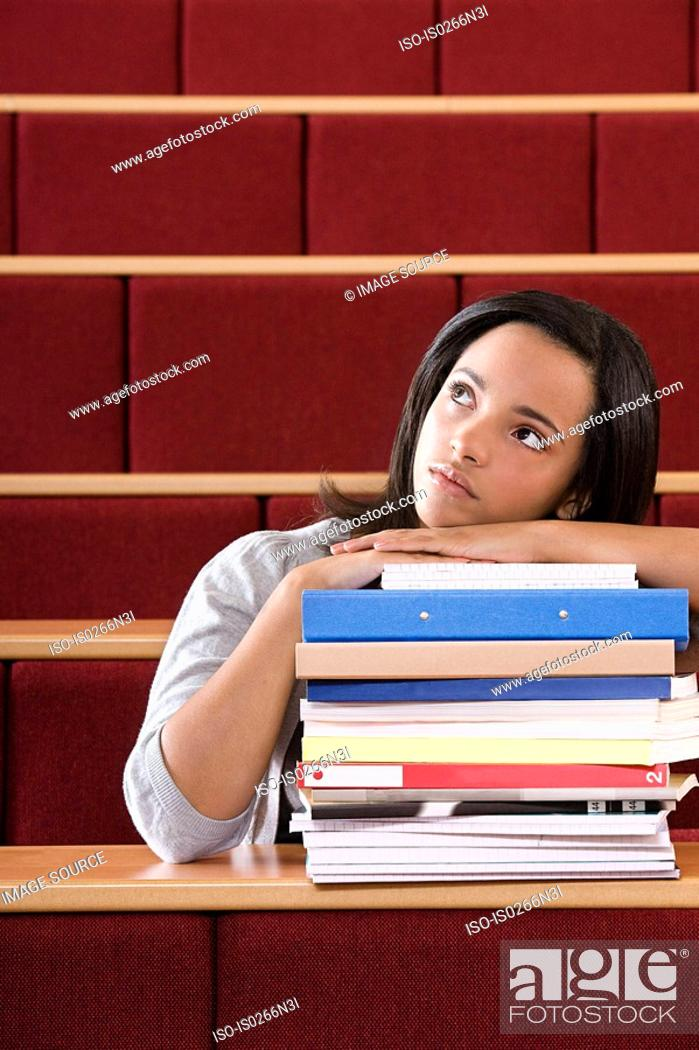 Stock Photo: Female student in lecture theatre.