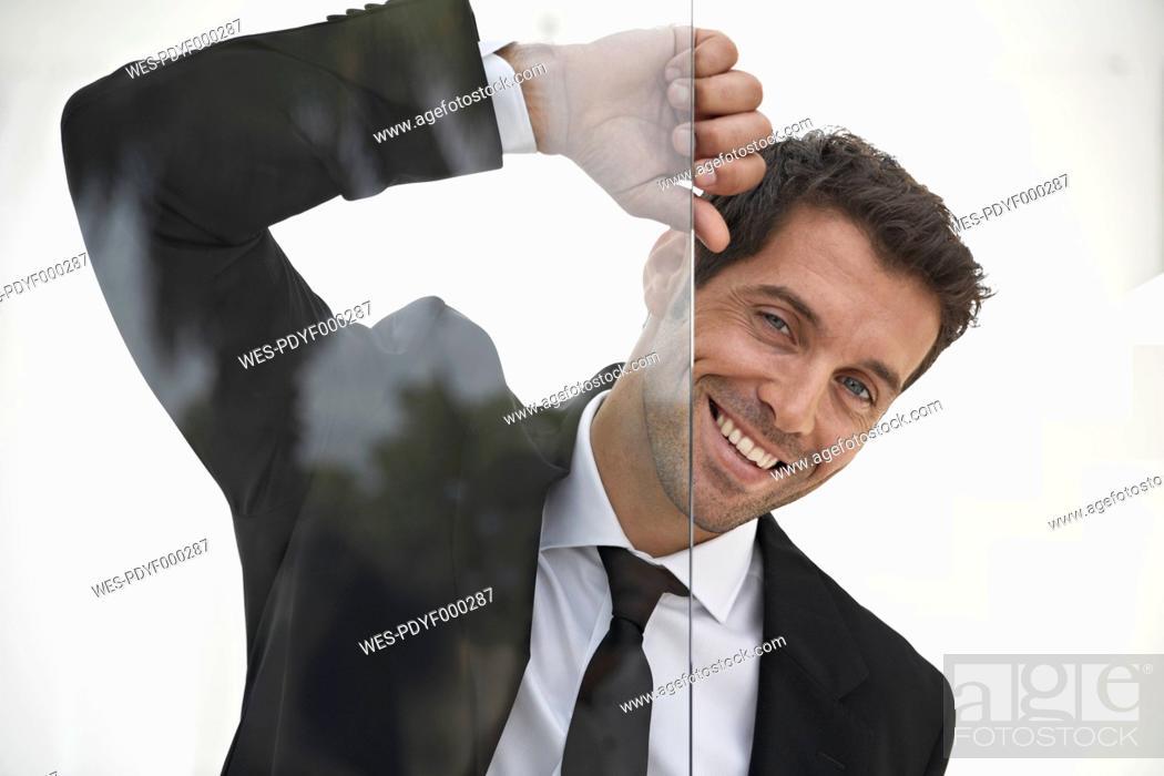 Stock Photo: Spain, Businessman smiling, portrait.