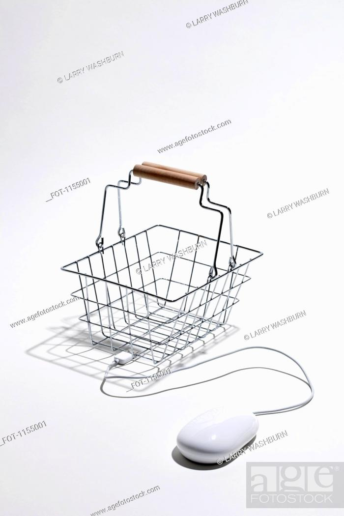 Stock Photo: Computer mouse connected to shopping basket for online shopping.