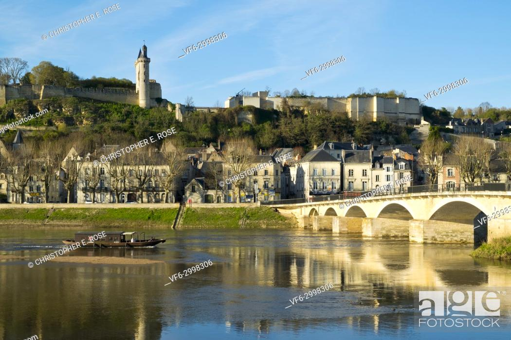 Stock Photo: Chinon town and chateau on the banks of the Vienne river on a sunny spring afternoon, Indre-et-Loire, France.