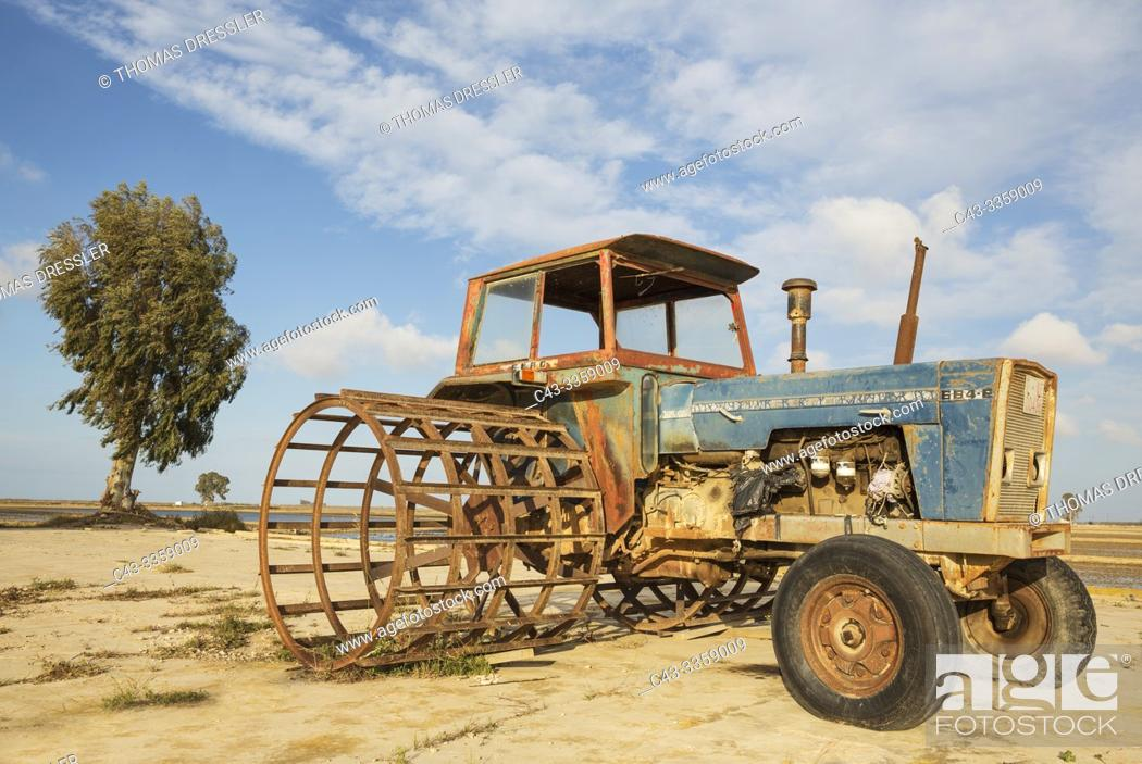 Stock Photo: Old tractor out of use next to flooded rice fields. Environs of the Ebro Delta Nature Reserve, Tarragona province, Catalonia, Spain.