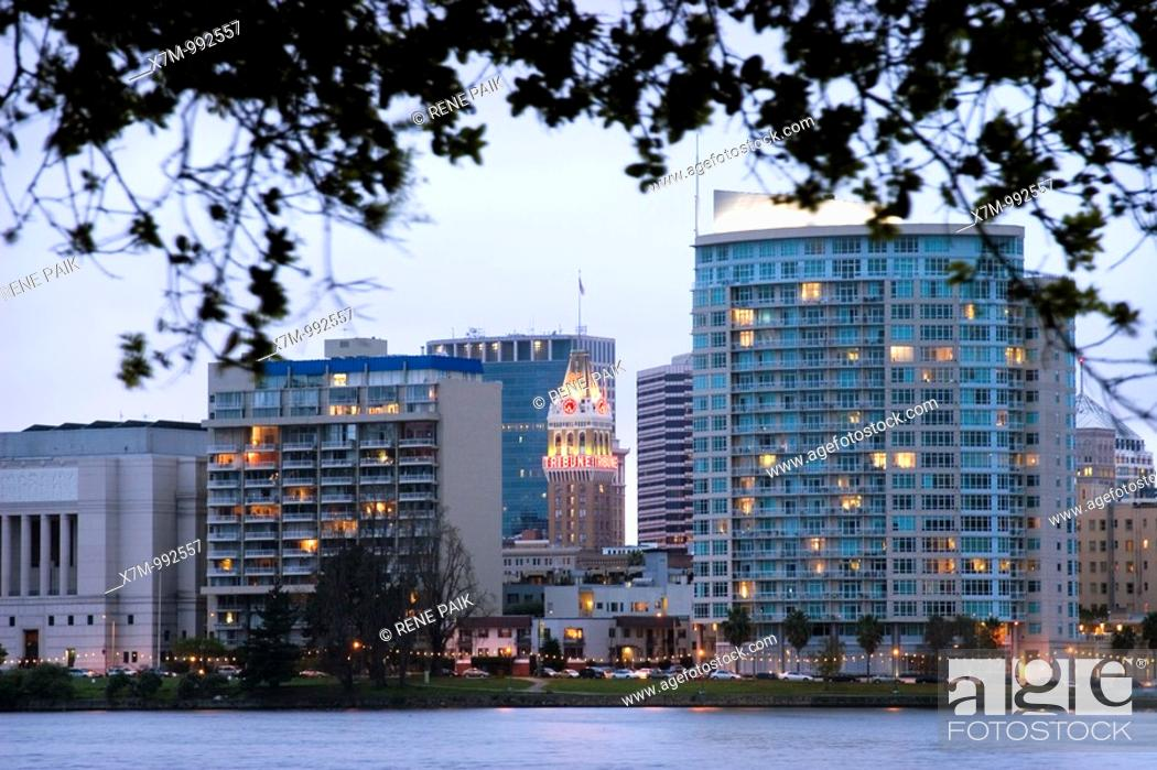 Stock Photo: View of the landmark Oakland Tribune building from across Lake Merritt on a stormy day  Lake Merritt is refered to as the Jewel of Oakland  It's the largest.