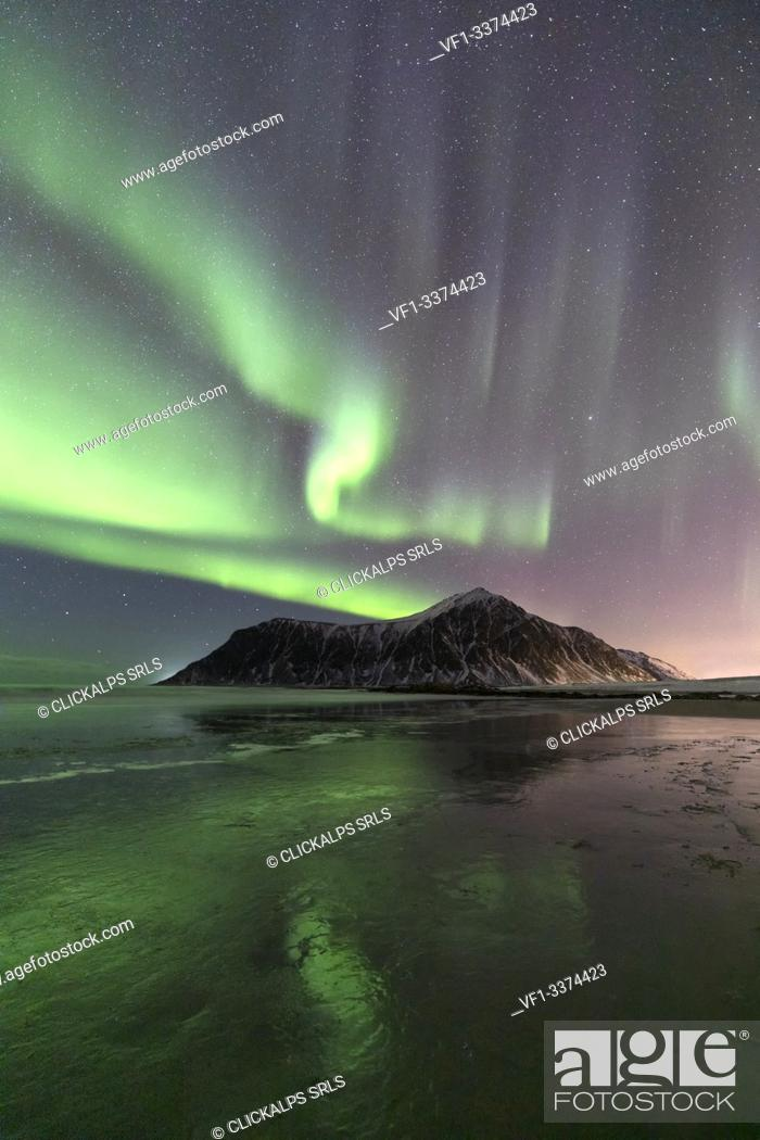 Stock Photo: A magical night whit Aurora borealis at Flakstad beach, Lofoten Islands, Northern Norway, Europe.