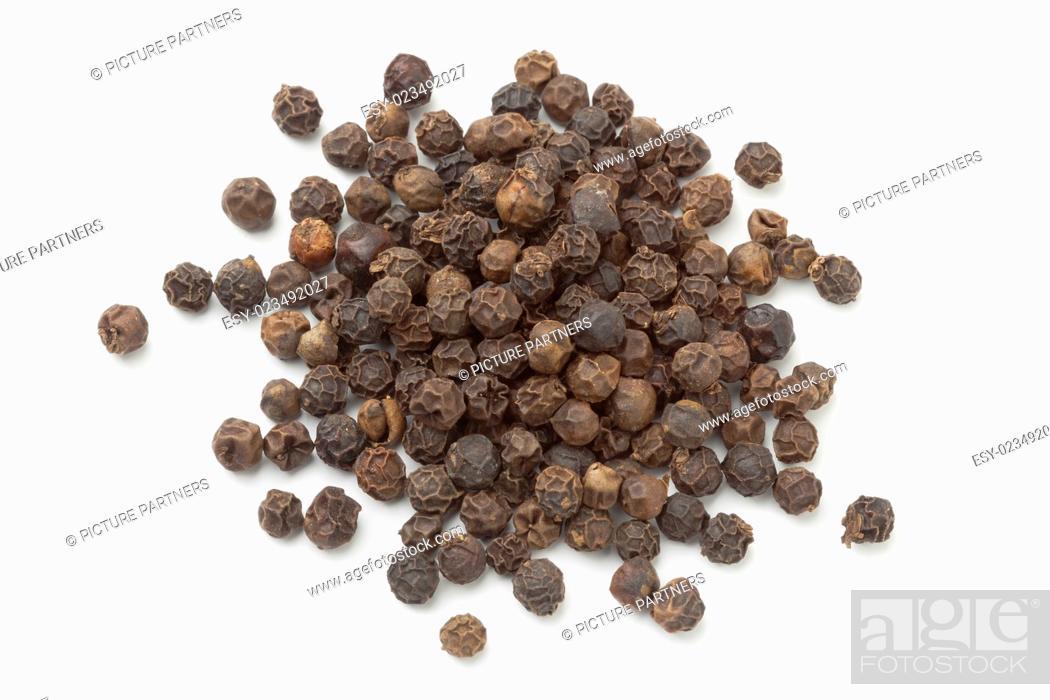 Stock Photo: Heap of black peppercorns on white background.
