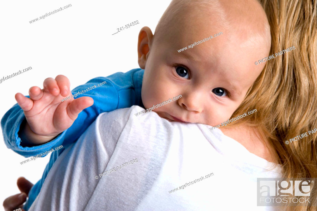 Stock Photo: Baby looking over mothers shoulder.